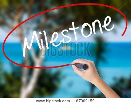 Woman Hand Writing Milestone With Black Marker On Visual Screen.
