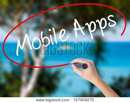 Woman Hand Writing Mobile Apps With Black Marker On Visual Screen