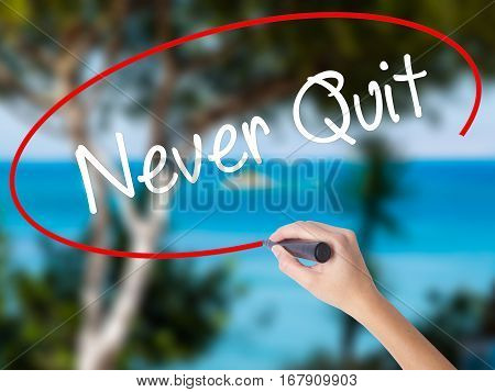 Woman Hand Writing Never Quit With Black Marker On Visual Screen.