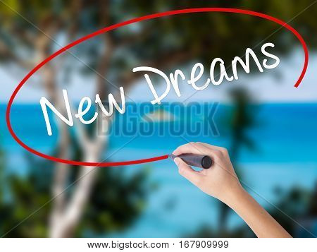 Woman Hand Writing New Dreams With Black Marker On Visual Screen