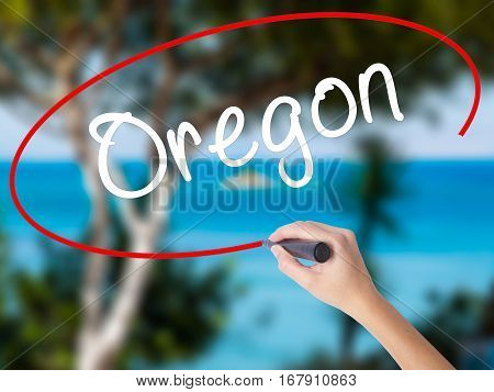 Woman Hand Writing Oregon With Black Marker On Visual Screen