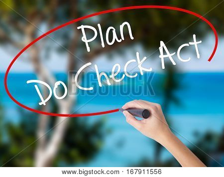 Woman Hand Writing Plan Do Check Act  With Black Marker On Visual Screen