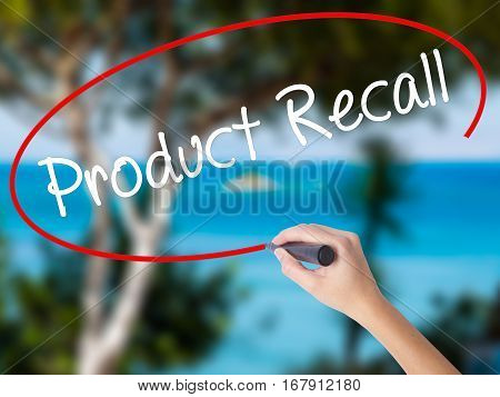 Woman Hand Writing Product Recall With Black Marker On Visual Screen