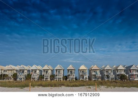 Blue Sky with a Row of Beach Homes along the gulf coast