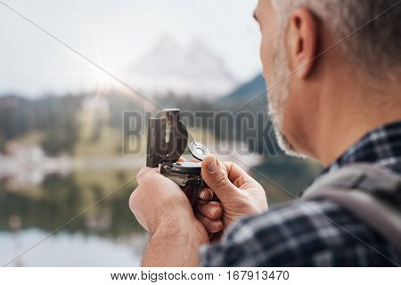 Hiker Using A Compass