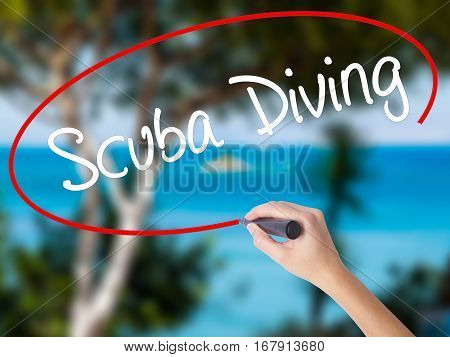 Woman Hand Writing Scuba Diving With Black Marker On Visual Screen