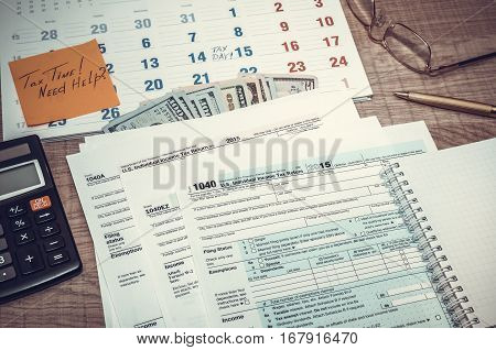 Tax Form With Calendar, Pen, Calculator, Notepad And Glasses. Toned Image