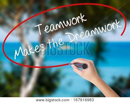 Woman Hand Writing Teamwork Makes The Dreamwork With Black Marker On Visual Screen
