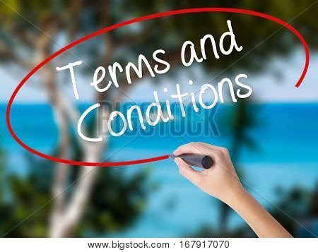 Woman Hand Writing Terms And Conditions With Black Marker On Visual Screen