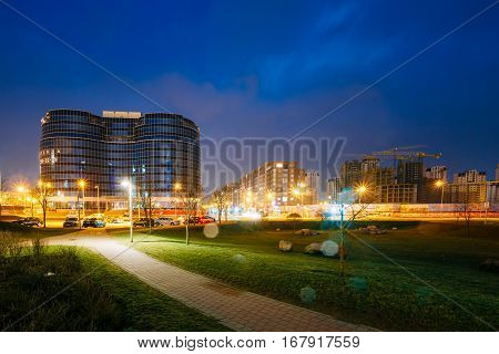 Minsk, Belarus - April 6, 2016:  Building Dana Mall In Evening Or Night Illumination. Construction Of Building Dana Mall In Independence Avenue