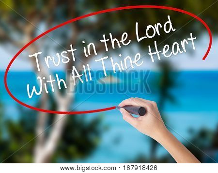 Woman Hand Writing Trust In The Lord With All Thine Heart With Black Marker On Visual Screen