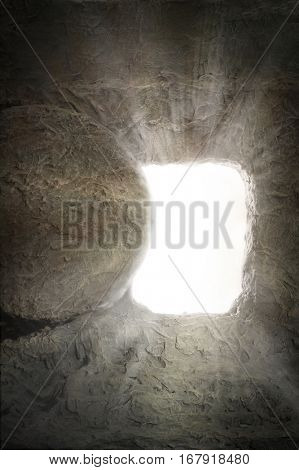 Empty tomb of Jesus with light coming from inside