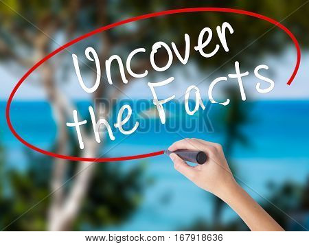 Woman Hand Writing Uncover The Facts With Black Marker On Visual Screen