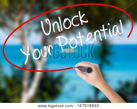Woman Hand Writing Unlock Your Potential With Black Marker On Visual Screen