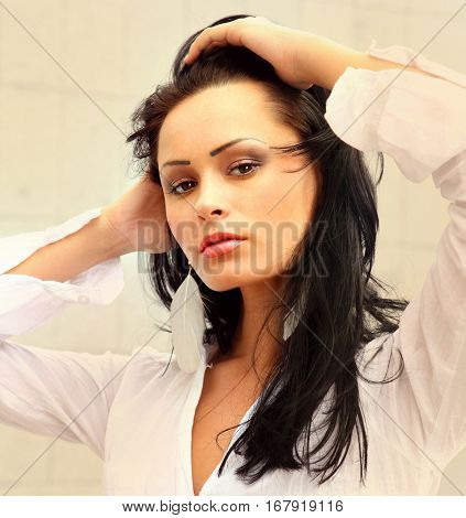 Portrait of young beautiful woman with healthy skin in white shirt