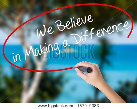 Woman Hand Writing We Believe In Making A Difference With Black Marker On Visual Screen