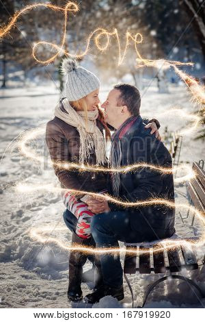 smiley lovers couple with sparklers happiness at winter time.St. Valantine