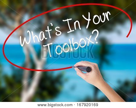 Woman Hand Writing  What's In Your Toolbox? With Black Marker On Visual Screen