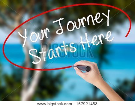 Woman Hand Writing Your Journey Starts Here With Black Marker On Visual Screen
