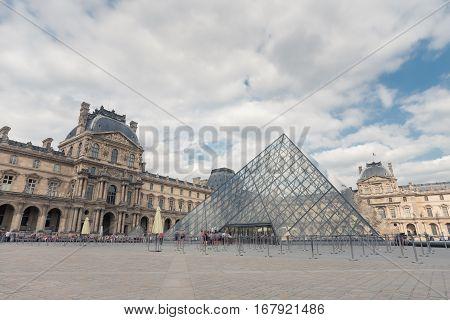 Paris, France - August 2016. Louvre Museum. Famous historical art landmark in Europe. Romantic, tourist, architecture, beautiful symbol. Day. Toned