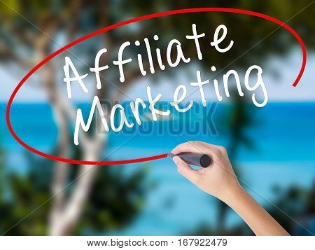 Woman Hand Writing Affiliate Marketing With Black Marker On Visual Screen