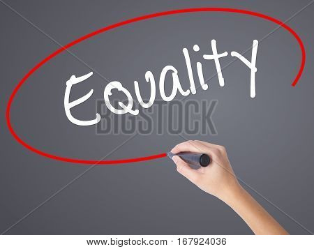Woman Hand Writing Equality  With Black Marker On Visual Screen