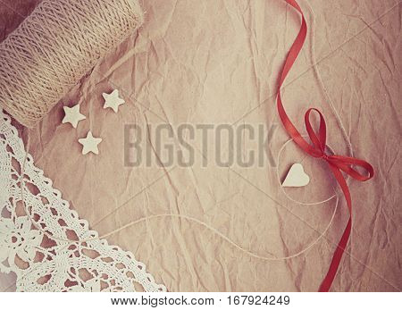 Vintage love card with heart, stars,ribbon,lace,bow,thread on crumpled old paper with empty space for your text, Valentine's romantic card
