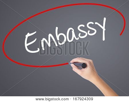 Woman Hand Writing Embassy With Black Marker On Visual Screen