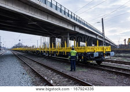 Burgas Bulgaria - January 27 2017 - Freight cargo train - 4-axled flat wagon Type:Res Model:072-2 - Transvagon AD