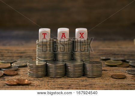 stack of coin and dice with tax wording,concept for tax time or financial.