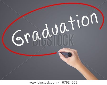 Woman Hand Writing Graduation With Black Marker On Visual Screen