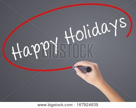 Woman Hand Writing Happy Holidays With Black Marker On Visual Screen