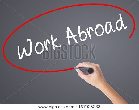 Woman Hand Writing Work Abroad With Black Marker On Visual Screen