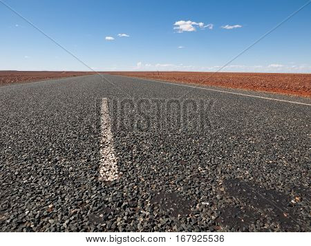 Australia Outback 09/10/2015 Long outback australian road with a beautiful blue sky disappearing into the horizon