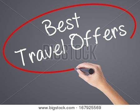 Woman Hand Writing Best Travel Offers  With Black Marker On Visual Screen
