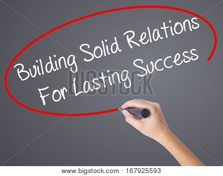 Woman Hand Writing Building Solid Relations For Lasting Success With Black Marker On Visual Screen