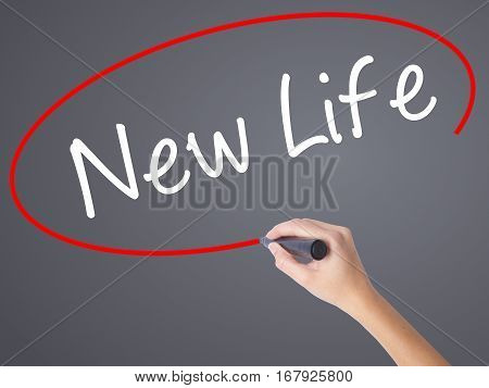 Woman Hand Writing New Life With Black Marker On Visual Screen