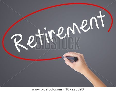 Woman Hand Writing Retirement With Black Marker On Visual Screen