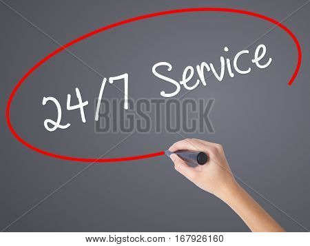 Woman Hand Writing 24/7 Service With Black Marker On Visual Screen