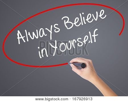 Woman Hand Writing Always Believe In Yourself With Black Marker On Visual Screen