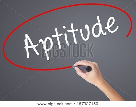 Woman Hand Writing Aptitude With Black Marker On Visual Screen
