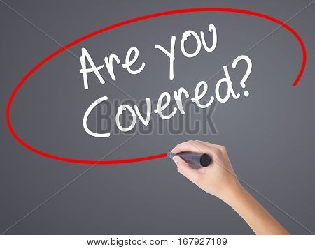 Woman Hand Writing Are You Covered? With Black Marker On Visual Screen