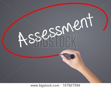 Woman Hand Writing Assessment With Black Marker On Visual Screen