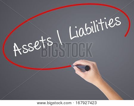 Woman Hand Writing Assets Liabilities With Black Marker On Visual Screen