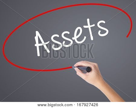Woman Hand Writing Assets With Black Marker On Visual Screen