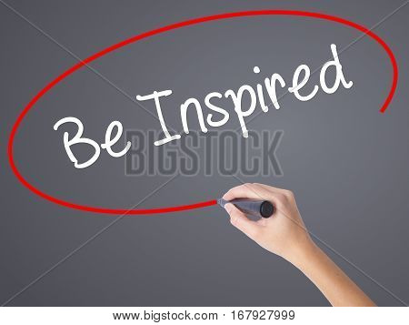 Woman Hand Writing Be Inspired With Black Marker On Visual Screen