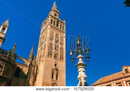 Famous Bell Tower named Giralda in landmark catholic Cathedral Saint Mary of the See in the morning, Seville, Andalusia, Spain