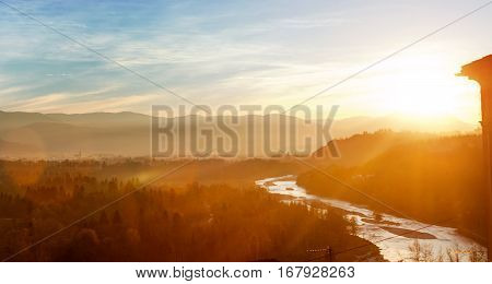 Bolzano Italy - view of forest mountains and creek near Bozen at sunset