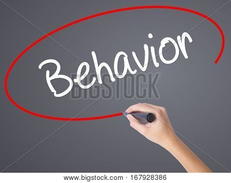 Woman Hand Writing Behavior With Black Marker On Visual Screen.
