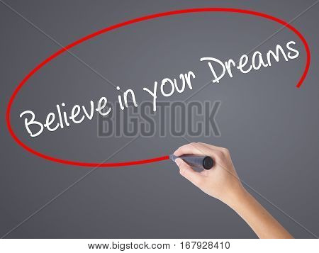 Woman Hand Writing Believe In Your Dreams With Black Marker On Visual Screen